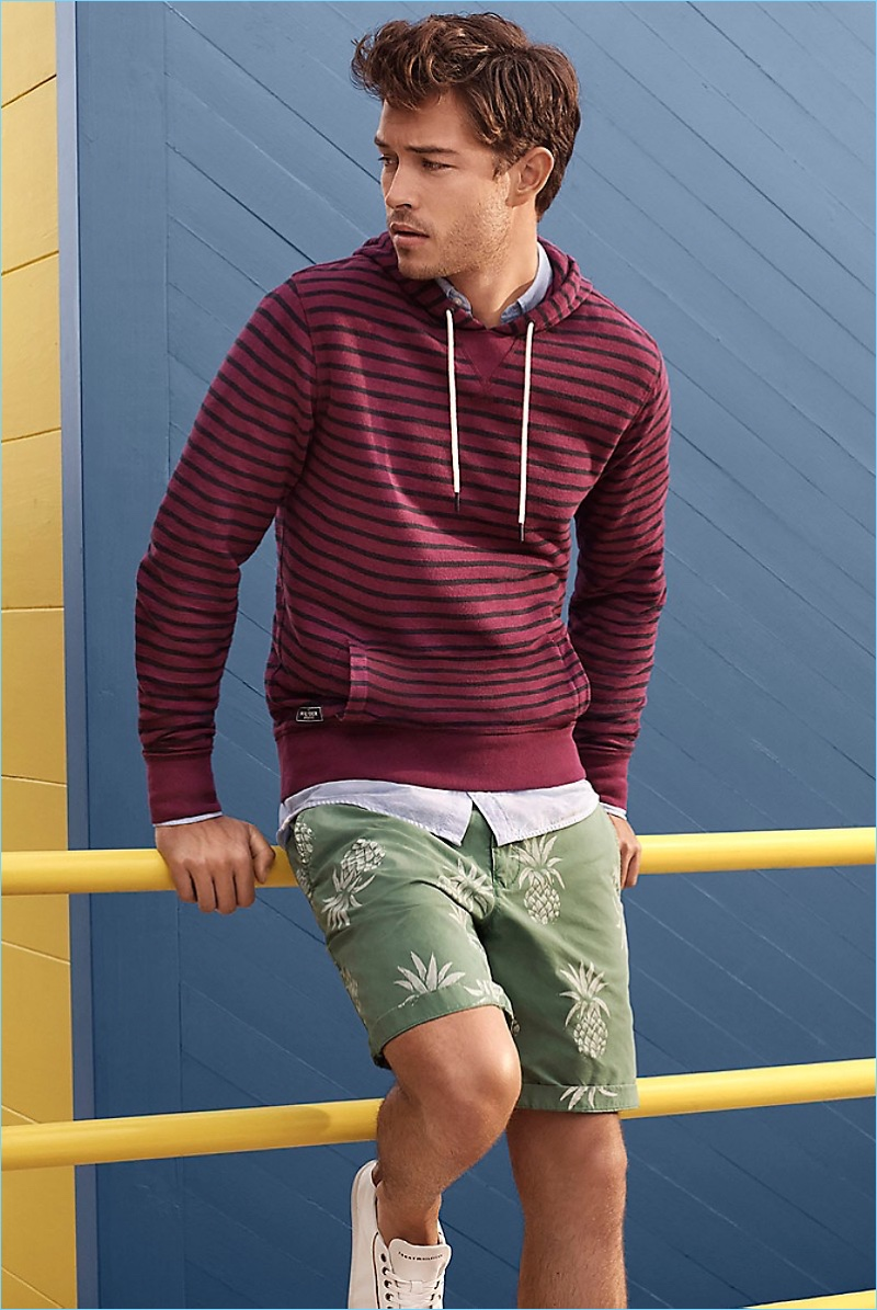 Print It Out: Francisco Lachowski sports a Tommy Hilfiger striped hoodie $119.50 and pineapple print club shorts $89.50.