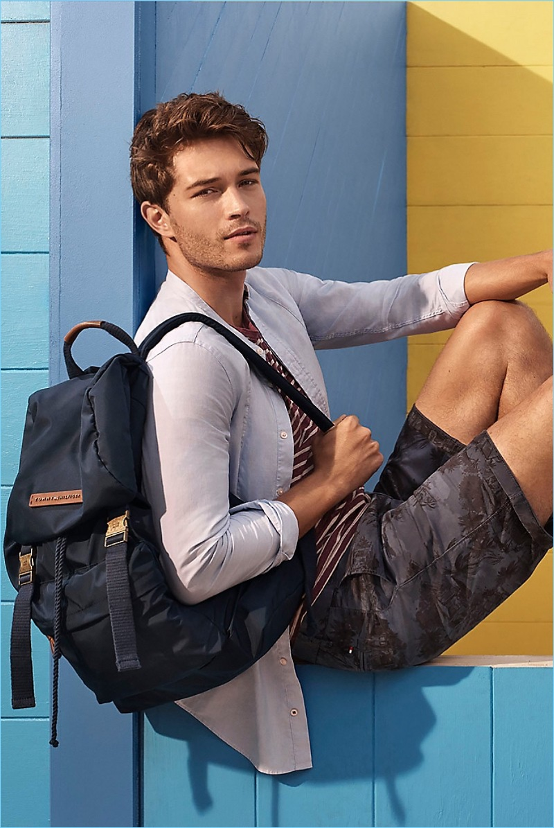 Cool and Tonal: Francisco Lachowski wears a Tommy Hilfiger striped tee $49.50, floral print shorts $99.50, and a slim-fit bib shirt $99.50.