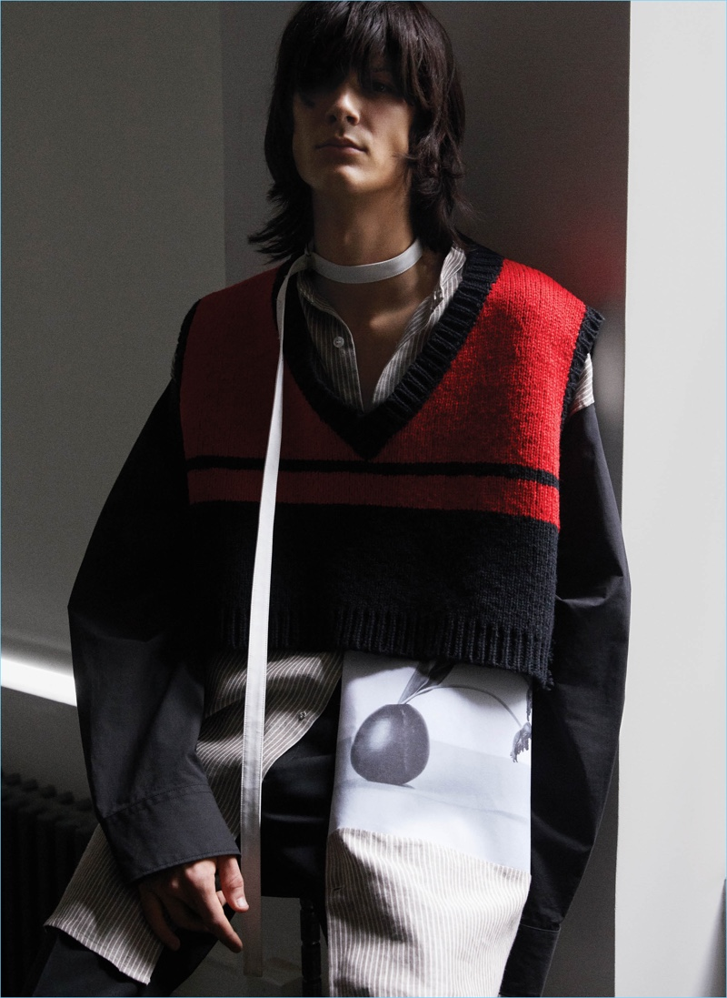 Ty Samatowic goes edgy in a cropped sweater vest and long shirt by Raf Simons.
