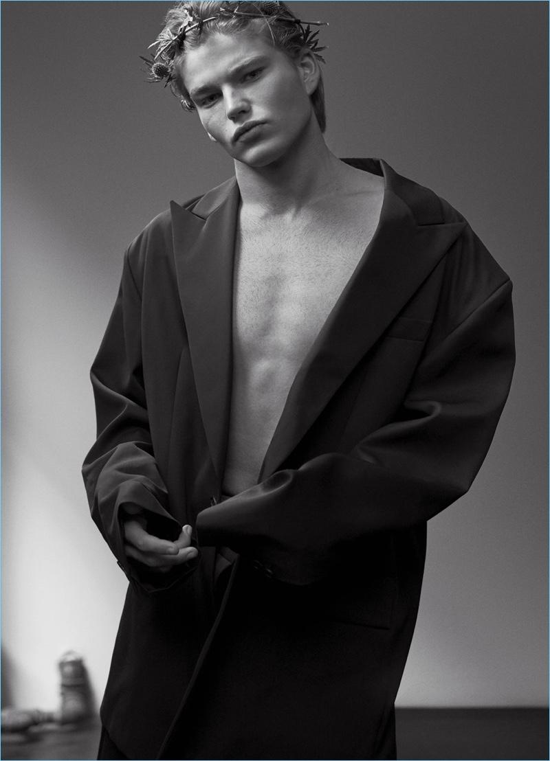 Jordan Barrett wears an oversized coat by JUUN.J.