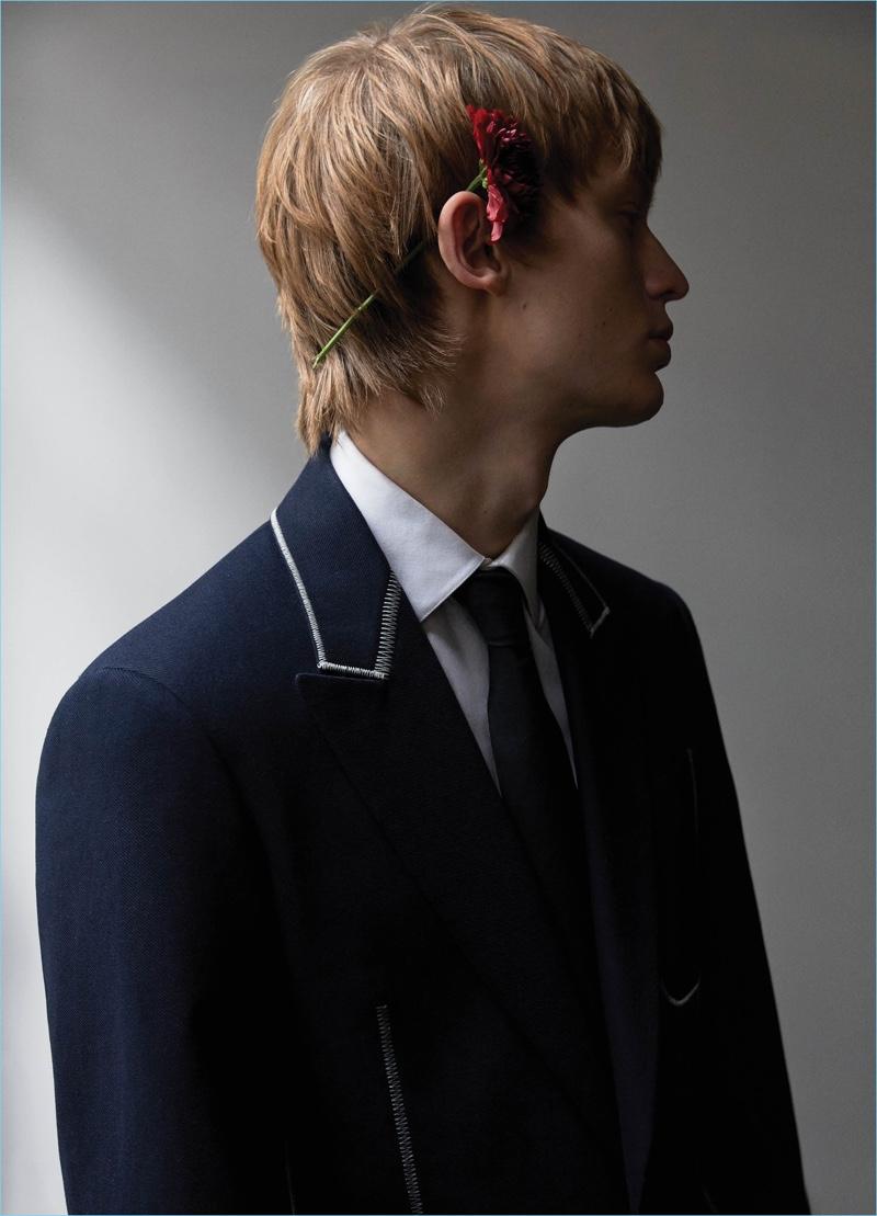 Jonas Glöer dons a Louis Vuitton blazer, shirt, and tie.