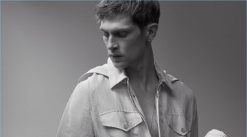 Mathias Lauridsen dons a J.W. Anderson jumpsuit with a Title of Work necklace.
