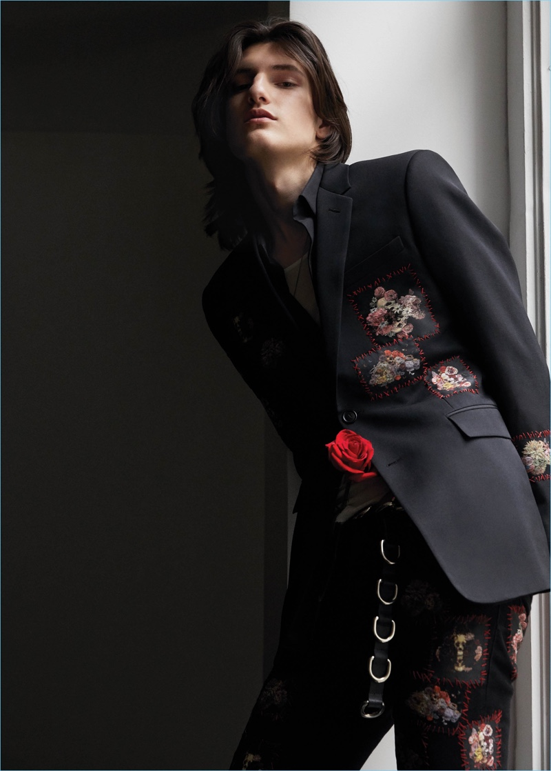 Lincoln Woelk makes a floral statement in a Dior Homme shirt, blazer, and jeans. He also sports a Rick Owens shirt underneath with a Linder belt.