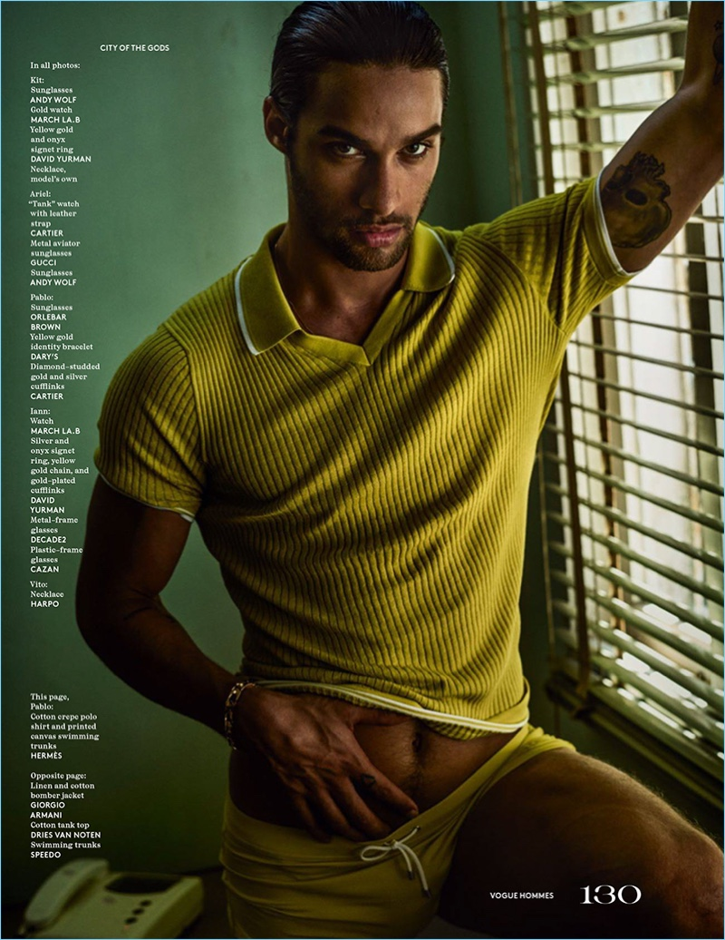 Pablo Morais wears a green knit polo and swimsuit by Hermes.