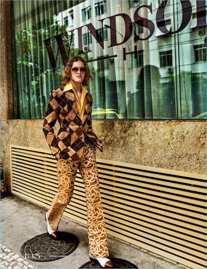 Ariel Rosa embraces a retro look in a patchwork jacket and silk trousers by Roberto Cavalli. The model also sports a vintage shirt and Salvatore Ferragamo shoes.