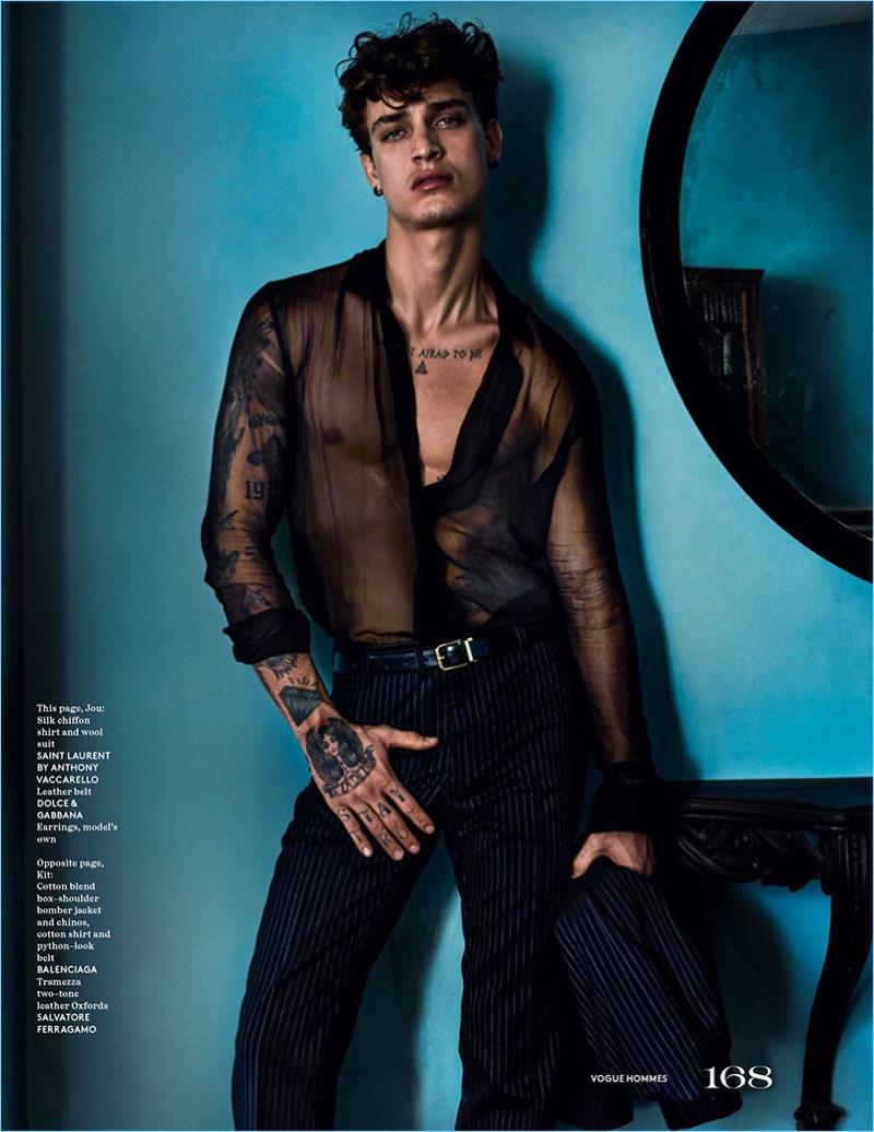Jonathan Bellini sports a sheer silk chiffon shirt and pinstripe trousers by Saint Laurent.