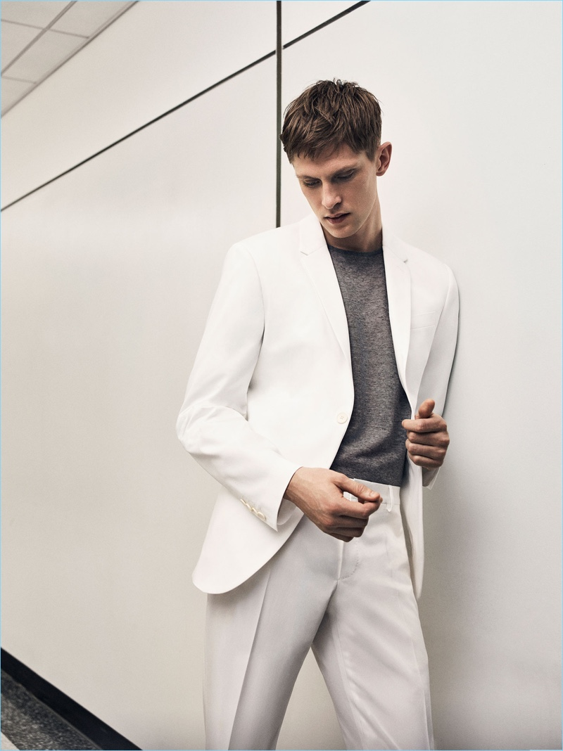 Danish model Mathias Lauridsen is a sleek vision in a summer white suit from Zara Man.