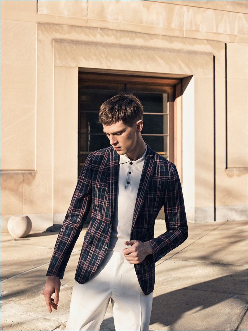 Stepping out, Mathias Lauridsen dons a checked Zara Man blazer with a polo shirt and pleated trousers.
