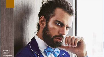 Delivering a fierce gaze, Spyros Christopoulos wears a jacket and cummerbund by Scalpers. Spyros also models a Sandro shirt, and Bowtie bow-tie.