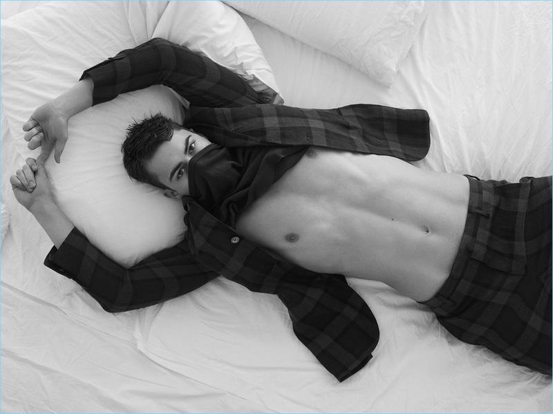 Posing for a cheeky photo, Alessio Pozzi rocks a Diesel t-shirt and plaid Boglioli suit.