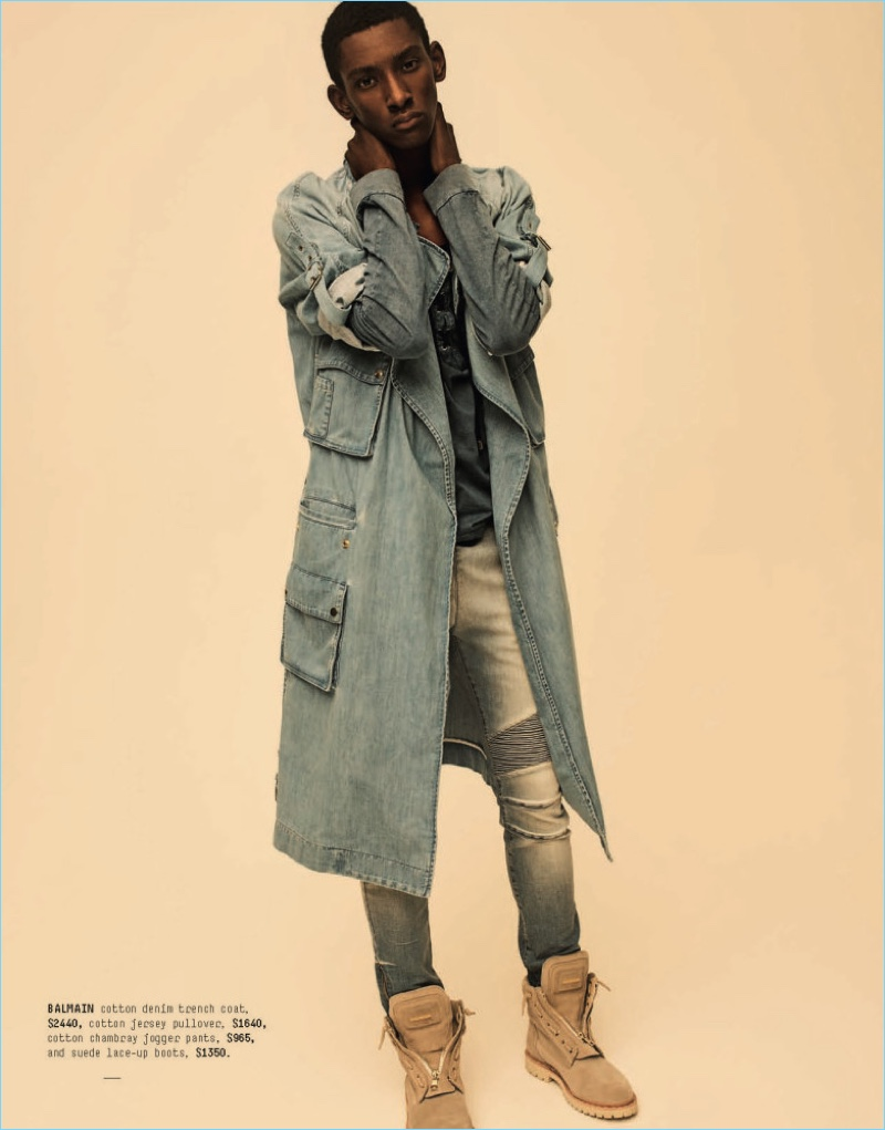 Sporting fashions from Balmain, Myles Dominique rocks standouts such as a denim belted trench coat $1,459.