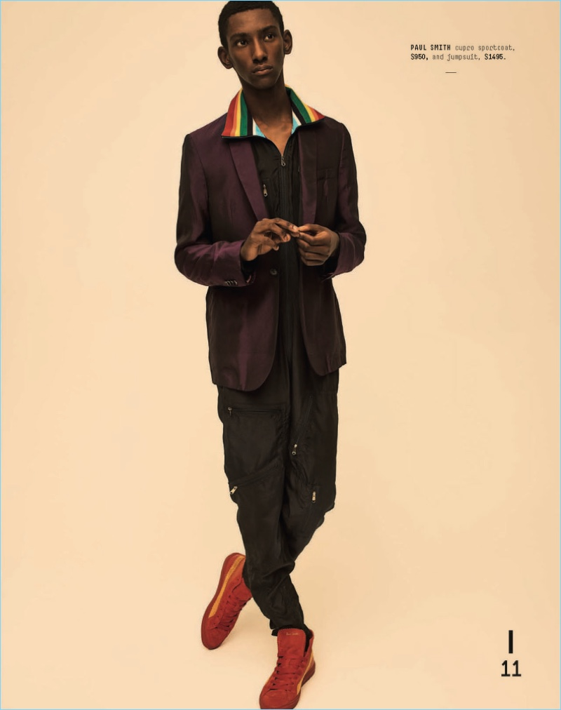 Making quite the statement, Myles Dominique sports a Paul Smith jumpsuit and sport coat.