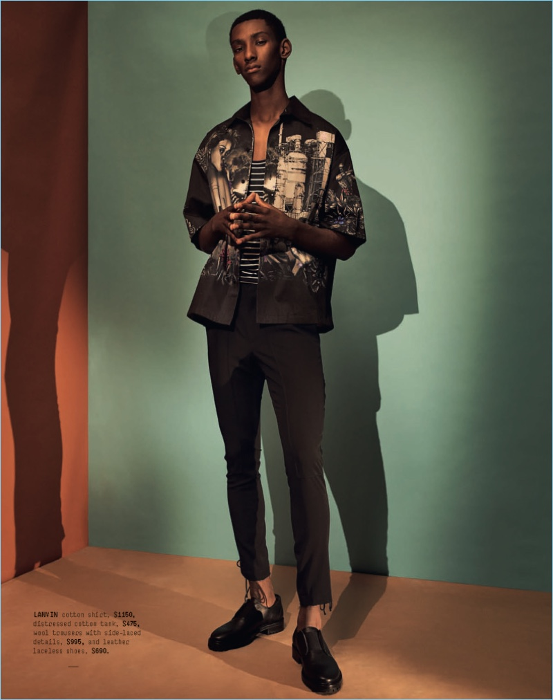 Myles Dominique wears a Lanvin graphic oversized shirt $689, laced-side wool trousers $599, and leather laceless bluchers $690.