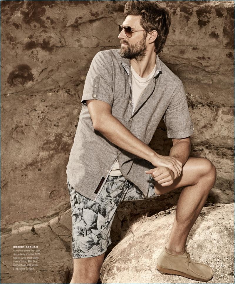 Embracing an earthy hues, RJ Rogenski wears a Robert Graham short-sleeve linen shirt $138 and v-neck t-shirt $78. He also sports Robert Graham floral print shorts $148.