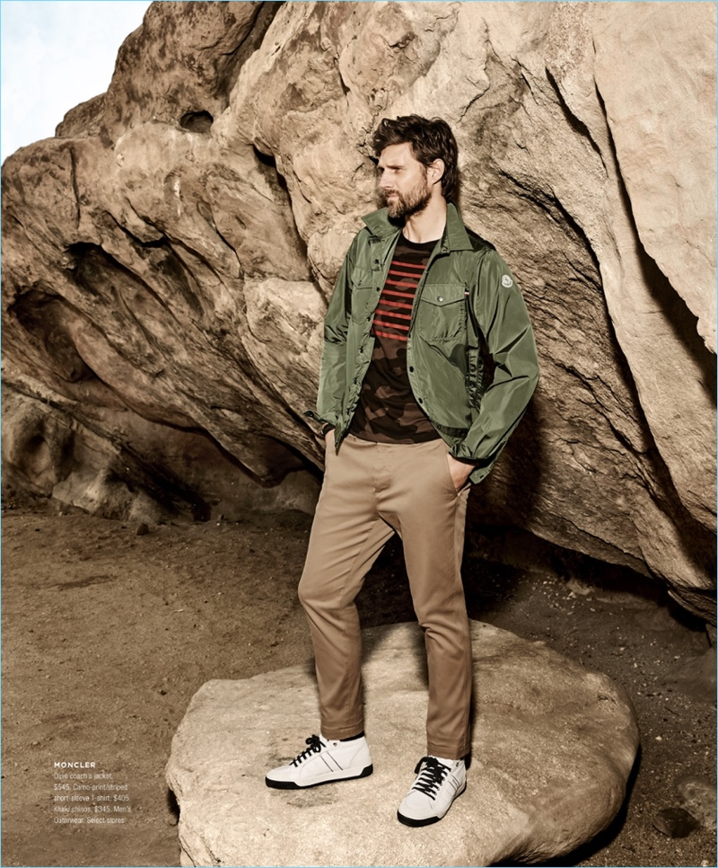 Bloomingdale's taps RJ Rogenski to model a look by Moncler. RJ rocks a Moncler coach's jacket $545 with a camo print t-shirt $405. He also wears khaki chinos $345.