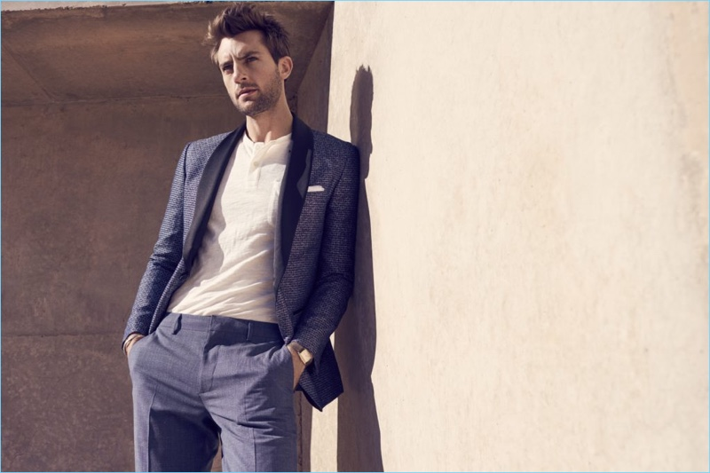 A sharp vision, Rafael Lazzini wears a dapper blue suit with a henley top.