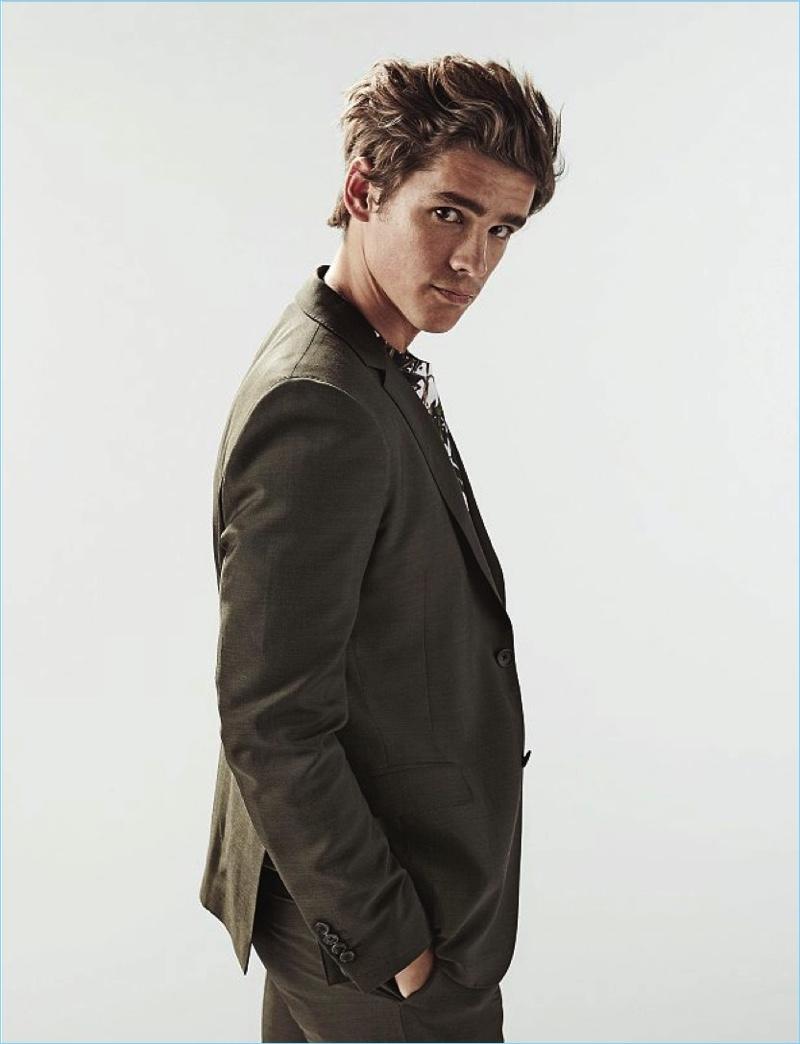 Actor Brenton Thwaites wears a tailored look by Salvatore Ferragamo.