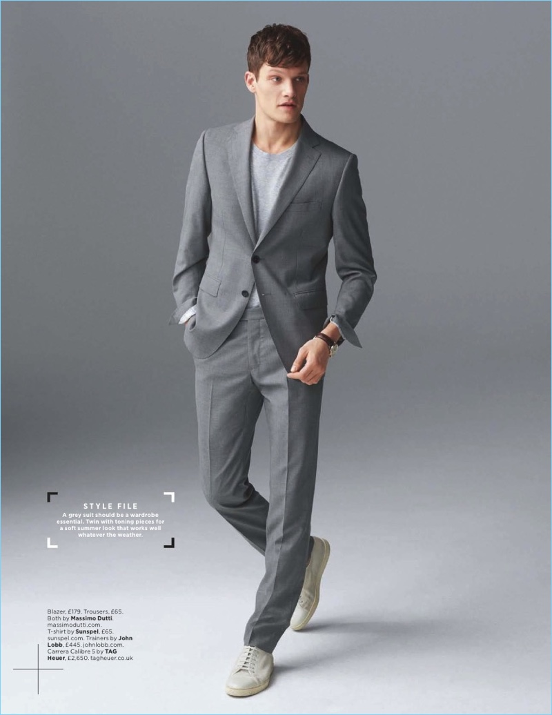 British model Danny Beauchamp wears a grey Massimo Dutti suit with a Sunspel t-shirt and John Lobb sneakers.