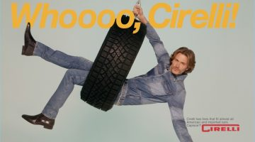 Swinging in a tire, Brad Kroenig wears a denim look by Valentino with Carvil Paris shoes.