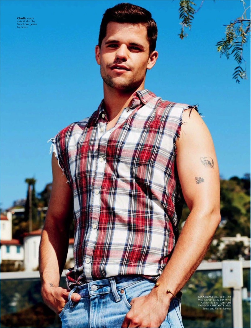 Actor Charlie Carver wears a New Look cut-off shirt with Levi's denim jeans.