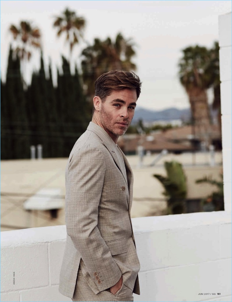 Stepping outside, Chris Pine wears a sharp suit by ISAIA.