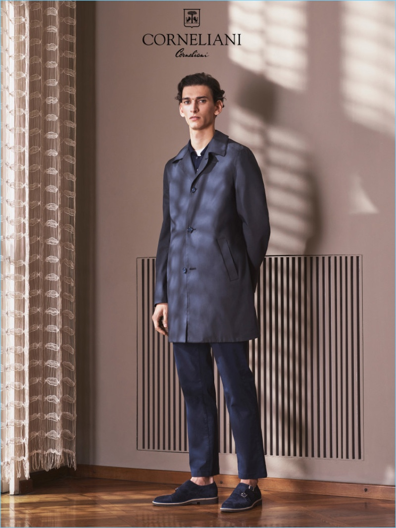 Model Thibaud Charon wears a sleek single-breasted coat and trousers for Corneliani's spring-summer 2017 campaign.