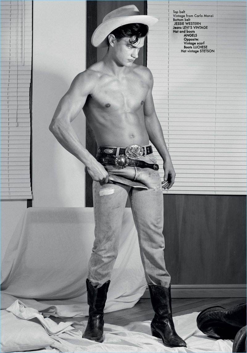 Damian Isper sports Levi's Vintage jeans with a Jessie Western belt. He also wears a hat and boots by Angels.