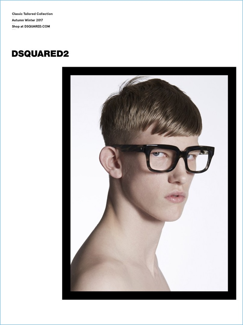 Starring in Dsquared2's Classic Tailored Collection fall-winter 2017 campaign, Connor Newall models thick framed glasses.