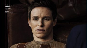 Front and center, Eddie Redmayne sports a sweater and trousers by Prada.