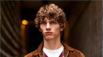 Erik van Gils wears a brown suede jacket by Officine Generale with a Rossignol sweater, and American Vintage t-shit. The model also sports Balibaris pants, and a David Yurman chain necklace.
