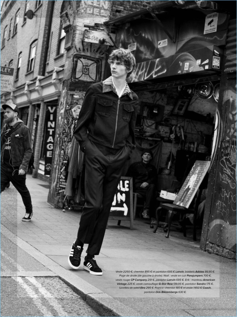 Model Erik van Gils wears a shirt, jacket, and pants by Lanvin with Adidas sneakers.