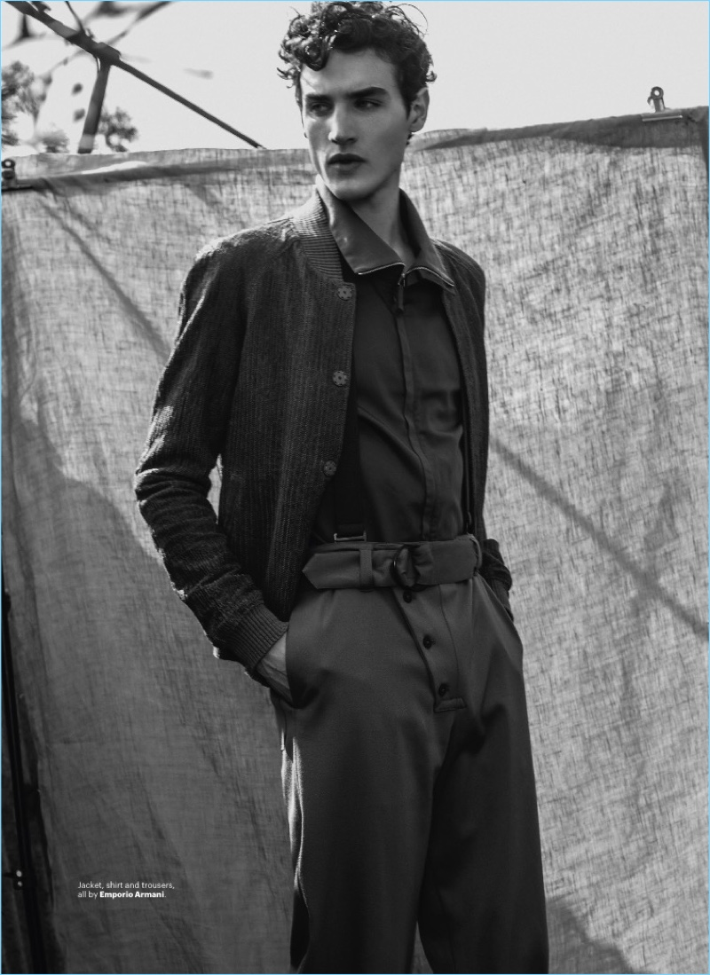 Embracing a military-inspired number, Federico Novello wears a shirt, jacket, and trousers from Emporio Armani.