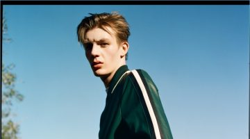 Finnlay Davis wears a green leather track suit by Bally.