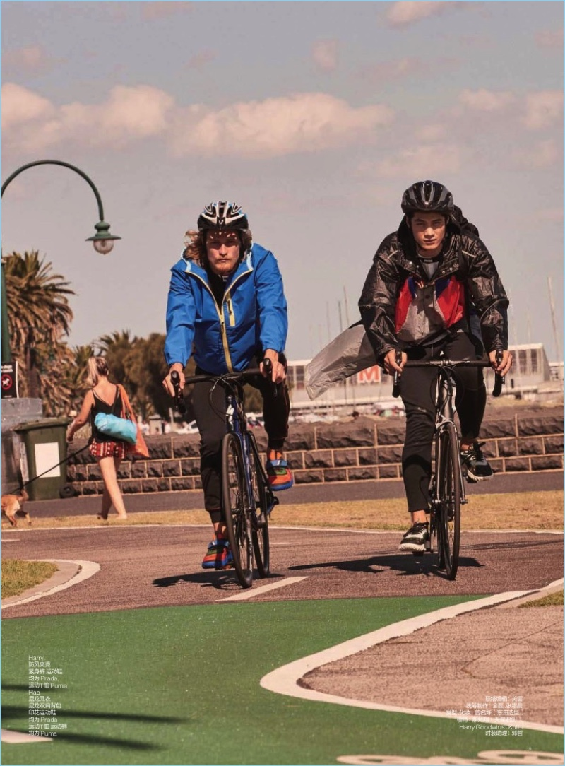 Harry Goodwins and Hao Yun Xiang ride bikes with GQ China. Both models wear Prada fashions with Puma sneakers.