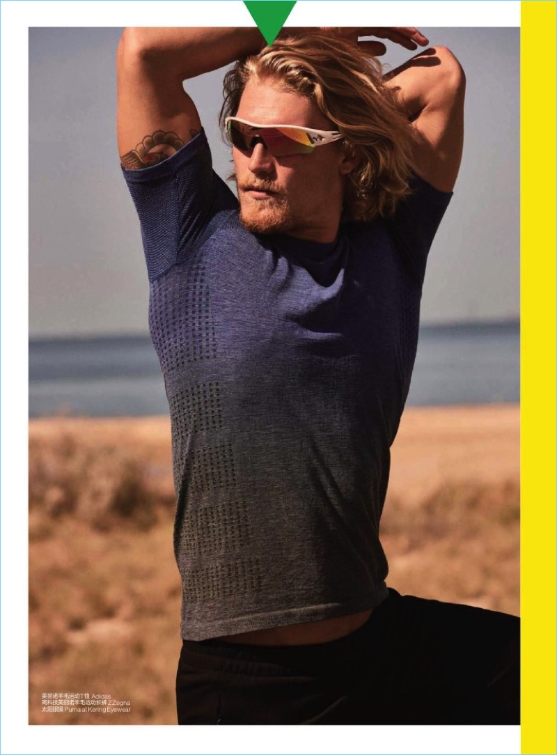 British model Harry Goodwins wears a sports shirt from Adidas with Z Zegna shorts, and Puma sunglasses.