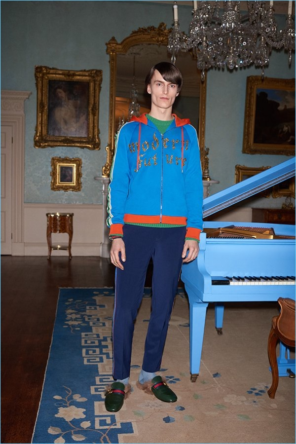 Mix colors with a Gucci hoodie $2,980, jacquard knit wool sweater $1,100, trousers $1,150, and shearling lined backless loafers $995.