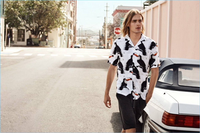 Ton Heukels sports a H&M Cuban collared resort shirt $24.99 and knee-length sweat shorts $24.99.