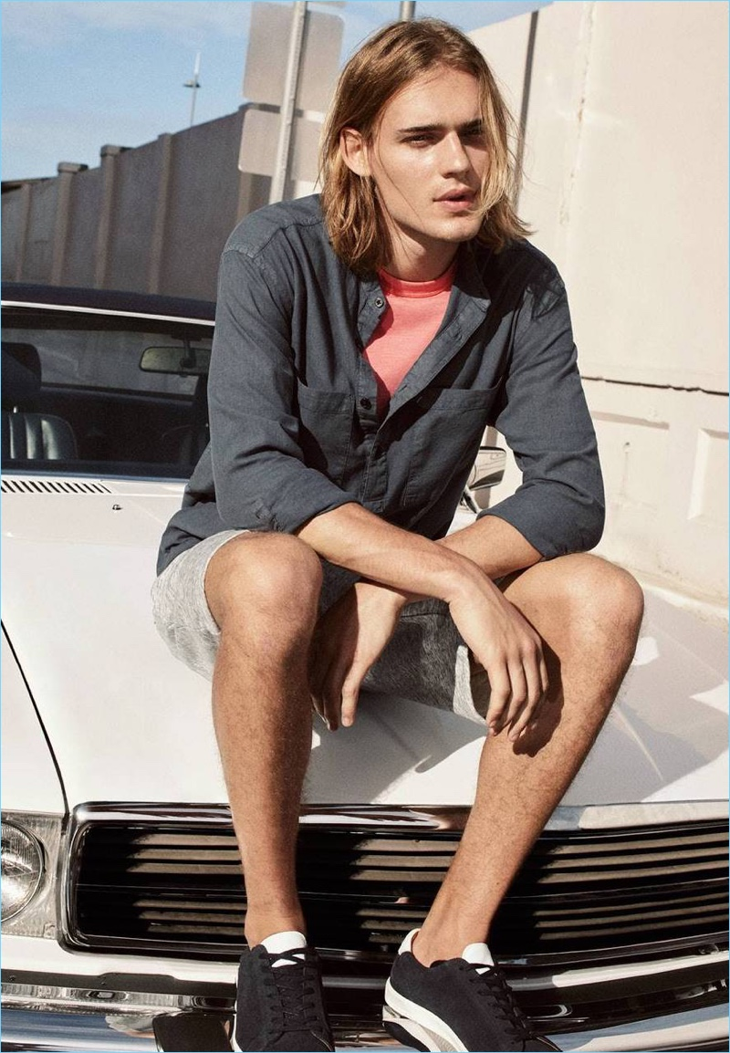 Relaxing, Ton Heukels wears a H&M linen-blend shirt $34.99, knee-length sweat shorts $24.99, a pocket tee $17.99, and sneakers $59.99.