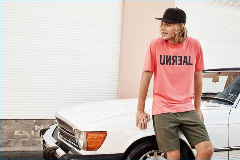 Tapping into laid-back style, Ton Heukels wears a H&M Unreal print t-shirt $12.99, linen-blend knee-length shorts $29.99, and a imitation suede cap $12.99.
