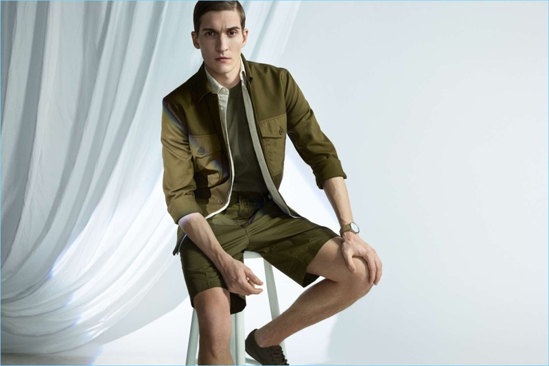 H&M champions the military trend with green fashions. Matvey Lykov wears a utility jacket with a pima cotton shirt and chino shorts.