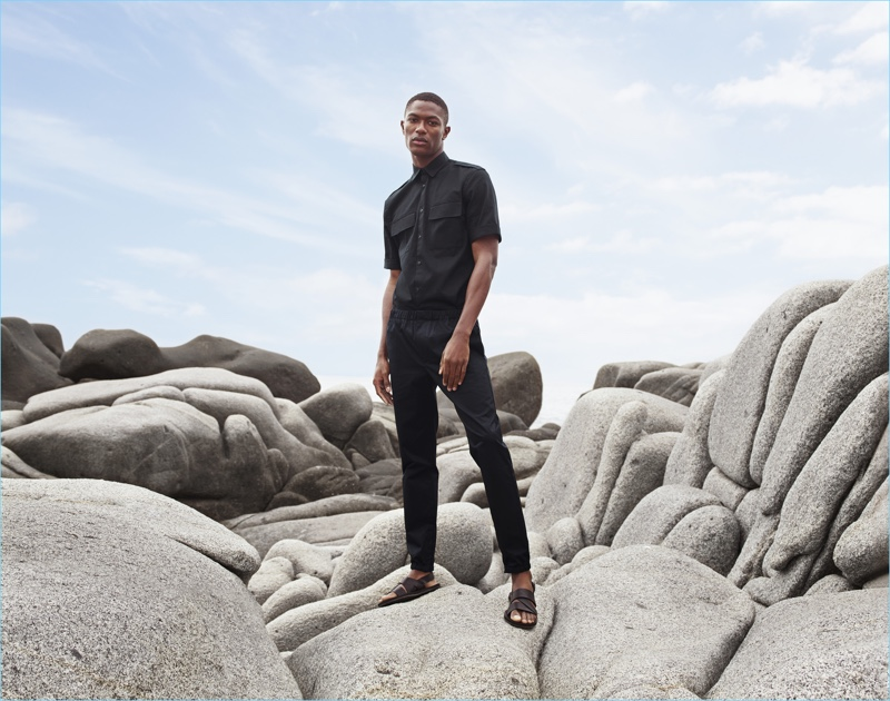 Hamid Onifade wears a short-sleeve utility shirt $24.99, elasticated pants, and leather sandals $24.99 for H&M's summer 2017 campaign.