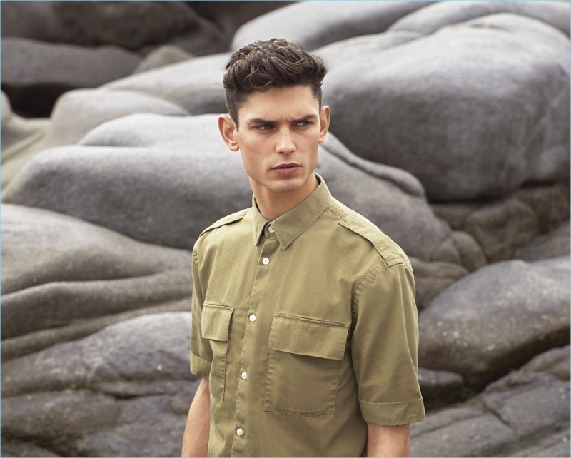 Arthur Gosse sports a khaki-beige short-sleeved utility shirt $24.99 for H&M's summer 2017 campaign.