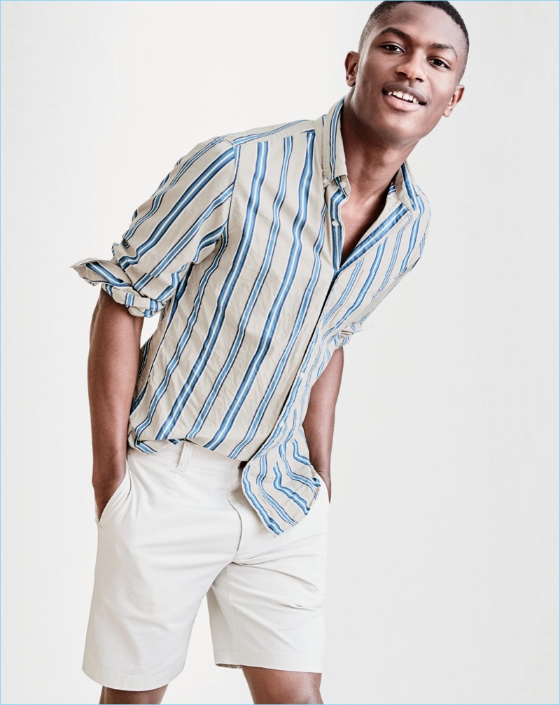 "All smiles, Hamid Onifade wears a J.Crew Secret Wash striped shirt with 9"" stretch shorts."