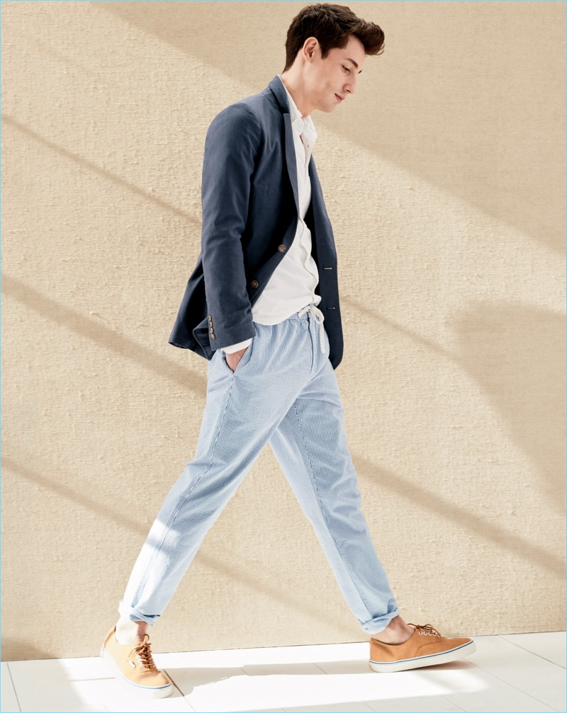 Nicolas Ripoll dons J.Crew drawstring pants in seersucker with a navy sport coat. He also wears a white oxford shirt and sneakers.