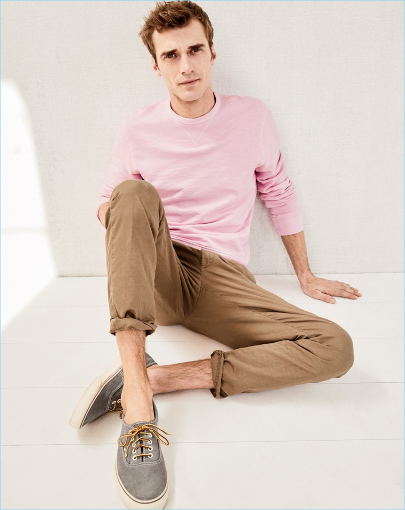 Front and center, Clément Chabernaud sports a J.Crew garment-dyed sweatshirt, stretch chino pants, and Vans for J.Crew washed canvas sneakers.