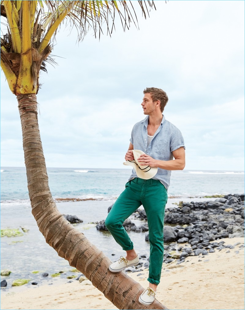 Ready for summer, Benjamin Eidem sports a J.Crew short-sleeve linen shirt $69.50 and striped tank $39.50. The French model also wears J.Crew garment-dyed chinos $70, a panama hat $65, and Vans $60.