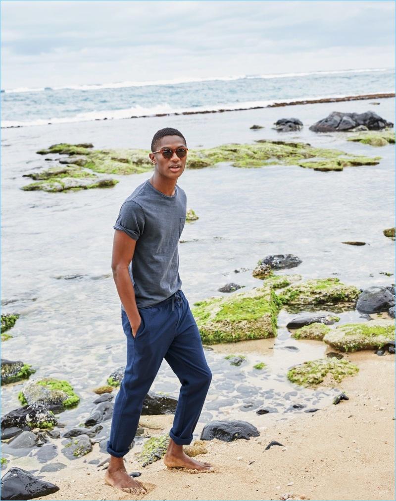 Heading to the beach, Hamid Onifade wears a J.Crew garment-dyed t-shirt $39.50 and seersucker drawstring pants $75.