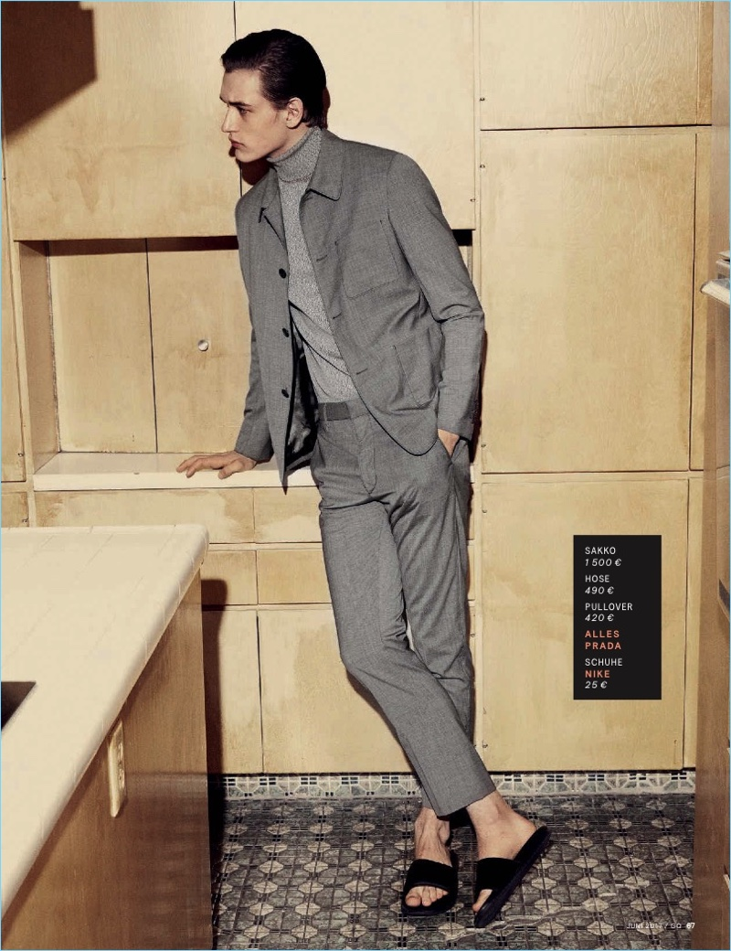Embracing shades of grey, Jegor Venned wears a turtleneck and suit by Prada with Nike sandals.