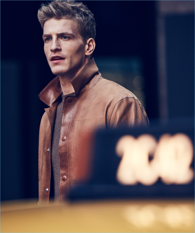 Front and center, Jesse Shannon sports an Ermenegildo Zegna leather jacket and cashmere sweater.