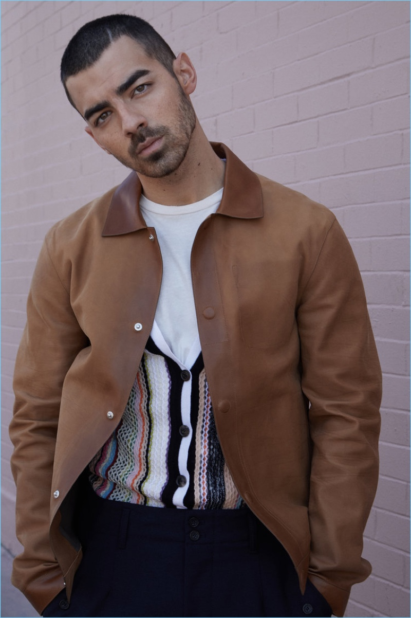 DNCE frontman Joe Jonas wears an Ermenegildo Zegna Couture leather jacket with a Missoni knit cardigan and Off-White tee.